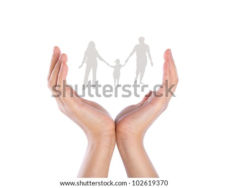 Hand with the paper cut of the family