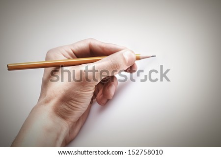 hand with the pencil. free space  - stock photo