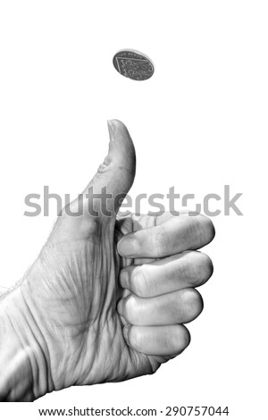 Hand with thumb flipping a coin into the air isolated on white background - risk or gambling concept. - stock photo