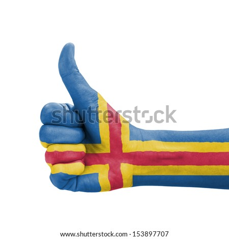 Hand with thumb up, Aland Islands flag painted as symbol of excellence, achievement, good - isolated on white background