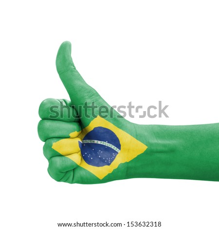 Hand with thumb up, Brazil flag painted as symbol of excellence, achievement, good - isolated on white background - stock photo
