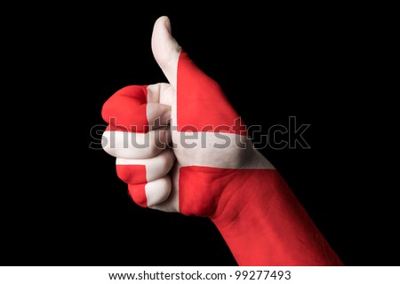 Hand with thumb up gesture colored in denmark national flag as symbol of excellence, achievement, good, - useful for tourism and touristic advertising