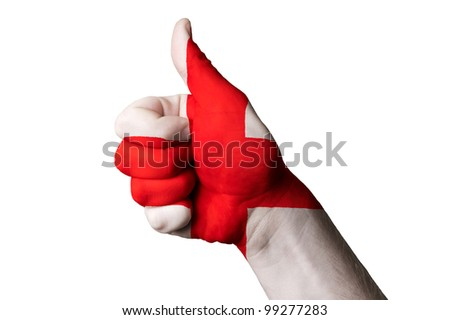Hand with thumb up gesture colored in england national flag as symbol of excellence, achievement, good, - useful for tourism and touristic advertising