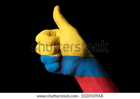 Hand with thumb up gesture in colored colombia national flag as symbol