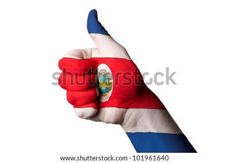 Hand with thumb up gesture in colored costa rica national flag as symbol of excellence, achievement, good, - for tourism and touristic advertising, positive political,  social management of country - stock photo