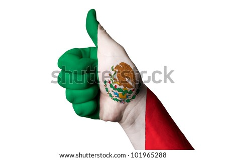 Hand with thumb up gesture in colored mexico national flag as symbol of excellence, achievement, good, - for tourism and touristic advertising, positive political, social management of country - stock photo