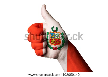 Hand with thumb up gesture in colored peru national flag as symbol of excellence, achievement, good, - for tourism and touristic advertising, positive political, social management of country - stock photo