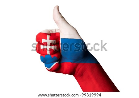 Hand with thumb up gesture in colored slovakia national flag as symbol of excellence, achievement, good, - useful for tourism and touristic advertising - stock photo