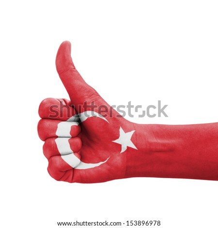 Hand with thumb up, Turkey flag painted as symbol of excellence, achievement, good - isolated on white background