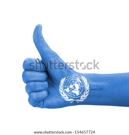 Hand with thumb up, UN (United Nations) flag painted as symbol of excellence, achievement, good - isolated on white background - stock photo