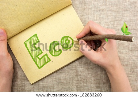 Hand with tree trunk pencil writing Eco doodle - stock photo