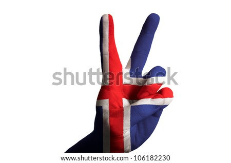 Hand with two finger up gesture in colored iceland national flag as