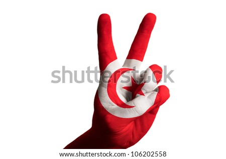 Hand with two finger up gesture in colored tunisia national flag as