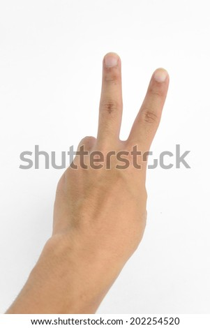 Hand with two fingers up in the peace or victory symbol isolated on white background - stock photo
