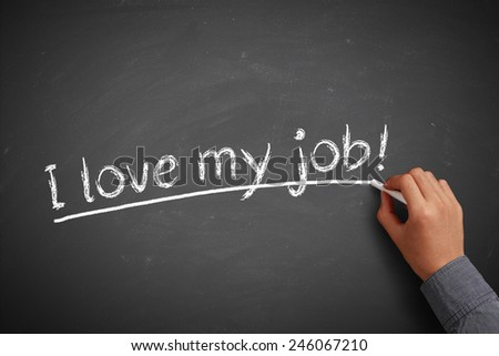 Hand with white chalk writing 'I love my job!' on chalkboard. - stock photo