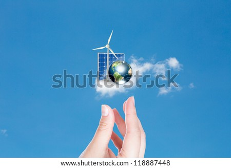 Hand with Wind turbines,solar cell and earth with hand over blue sky (Elements of this image furnished by NASA) - stock photo