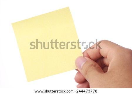 Hand with yellow sticky note isolated on white background. - stock photo