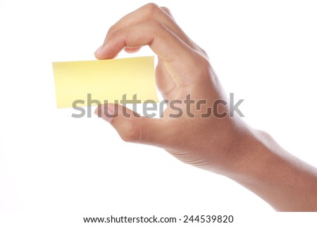 Hand with yellow sticky note isolated on white background.