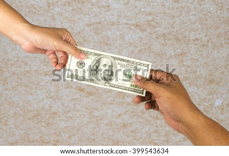 Hand woman and man give money on brown paper background