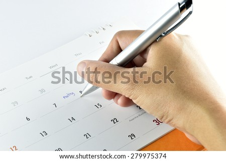 hand woman checking meeting plan in calendar background.