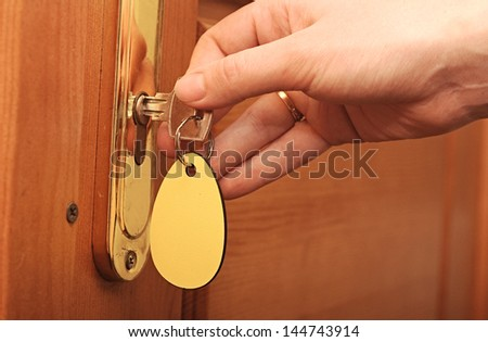 Hand, women are unlocked door - stock photo