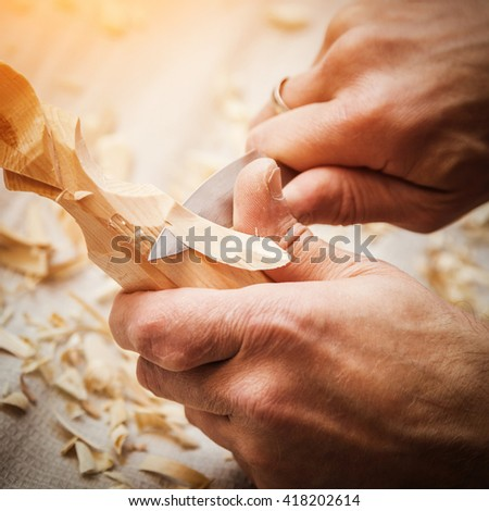 hand woodcarver - stock photo