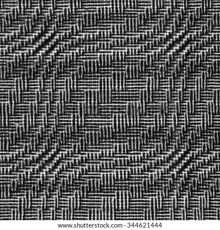 Hand-woven fabric with geometric pattern  - stock photo