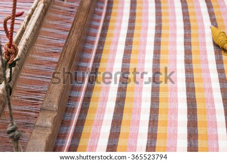 Hand woven on loom product of natural dyeing fabric  - stock photo