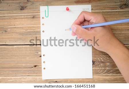 Hand write on the paper note on wood - stock photo