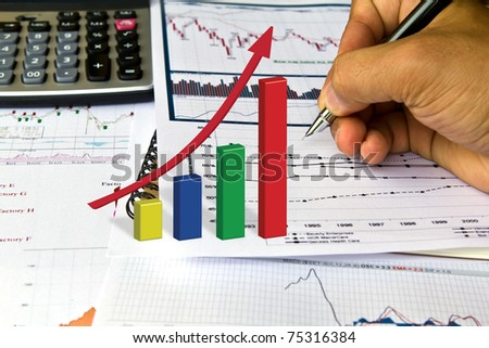 Hand write on Various financial charts on the table with calculator - stock photo