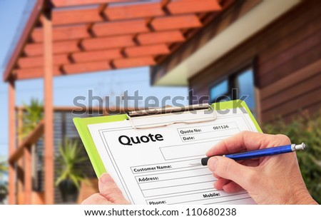 Hand writing a quote on a clipboard for Home Building Renovation