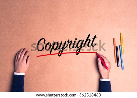 Hand writing a single word Copyright on paper - stock photo