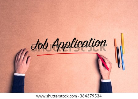 Hand writing a single word Job Application on paper - stock photo