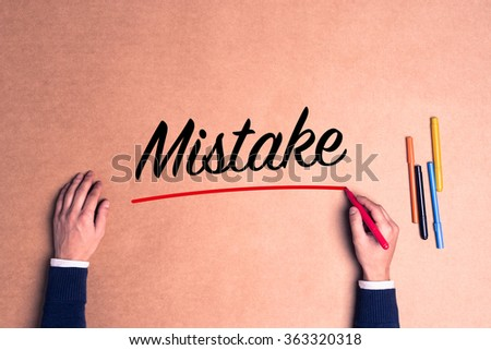 Hand writing a single word Mistake paper - stock photo