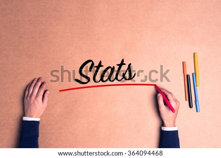 Hand writing a single word Stats on paper - stock photo