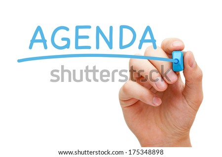 Hand writing Agenda with blue marker on transparent wipe board. - stock photo