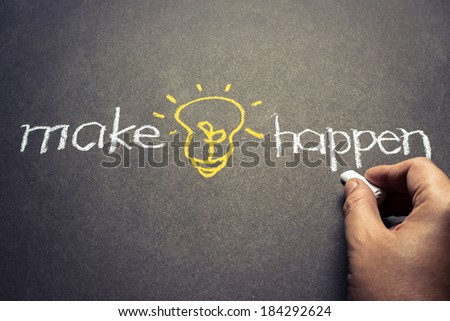 Hand writing and sketching light bulb for Making idea happen concept - stock photo