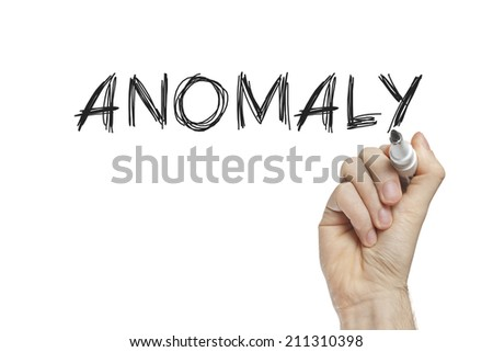 Hand writing anomaly on a white board - stock photo
