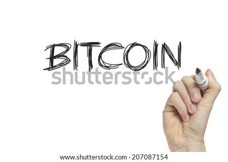 Hand writing bitcoin on a white board - stock photo