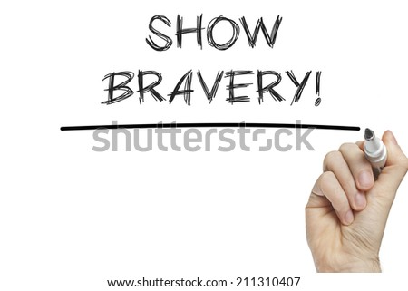 Hand writing bravery on a white board