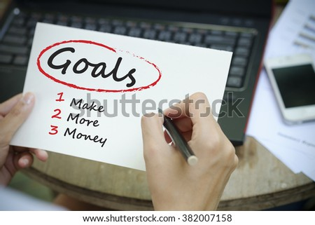 hand writing  business goals Plan concept on white notebook , business concept ,business goals  concept  - stock photo