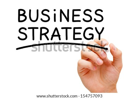 Hand writing Business Strategy with black marker on transparent wipe board.