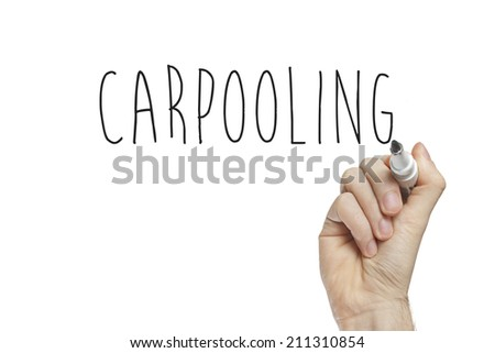 Hand writing carpooling on a white board - stock photo