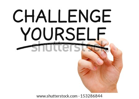 Hand writing Challenge Yourself with black marker on transparent wipe board. - stock photo