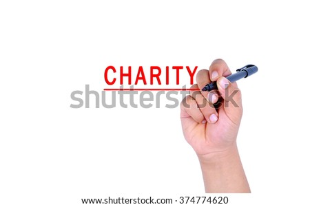 Hand writing charity with marker on transparent wipe board. - stock photo