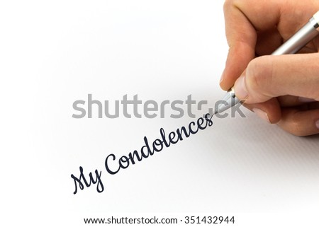 "Hand writing ""Condolences""  on white sheet of paper. - stock photo"