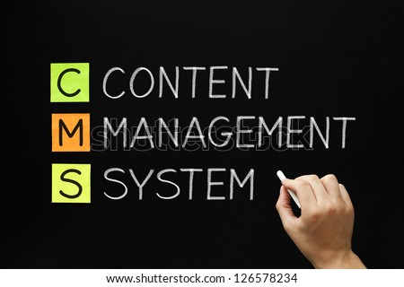 Hand writing Content Management System with white chalk on blackboard. - stock photo