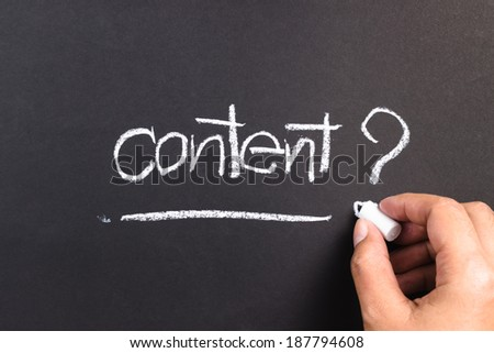 Hand writing Content word with chalk