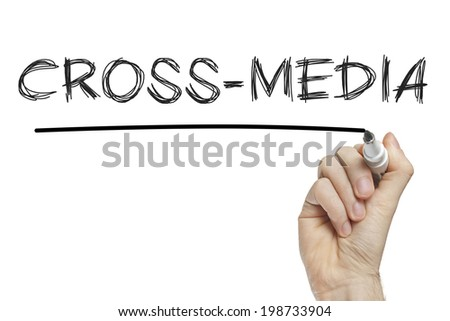 Hand writing cross media on a white board - stock photo