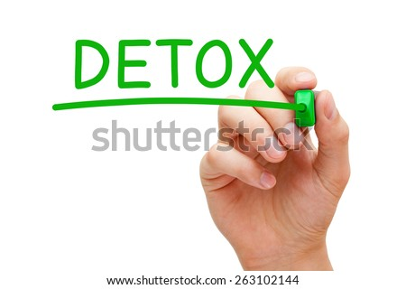 Hand writing Detox with green marker on transparent wipe board. - stock photo